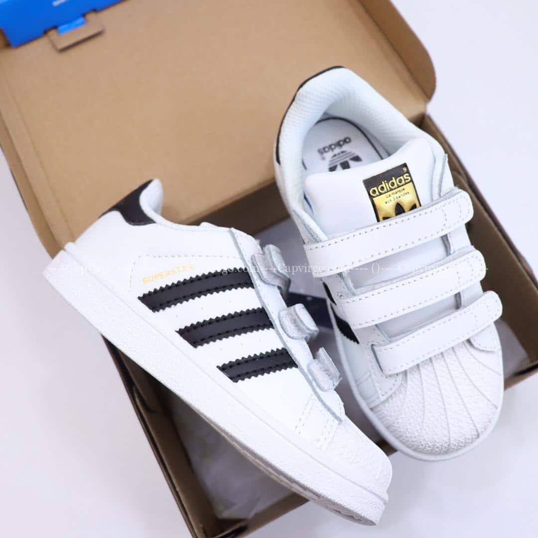 Giày trẻ em adidas Superstar trắng sọc đen dán dính