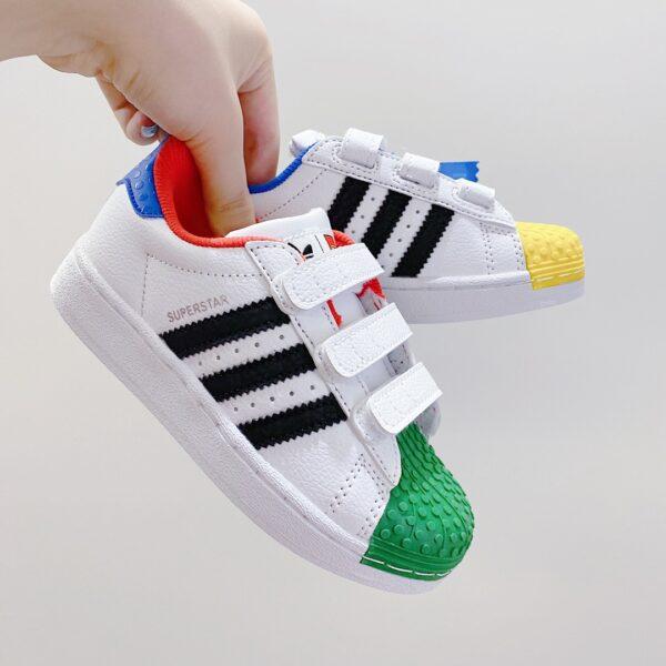Giày thể thao trẻ em AD × LEGO Shell Toe mũi giày xanh vàng