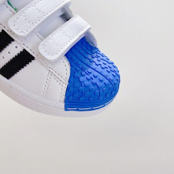 Giày thể thao trẻ em AD × LEGO Shell Toe mũi giày xanh đỏ